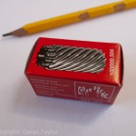A new blade for the Caran d'Ache sharpener in its box.