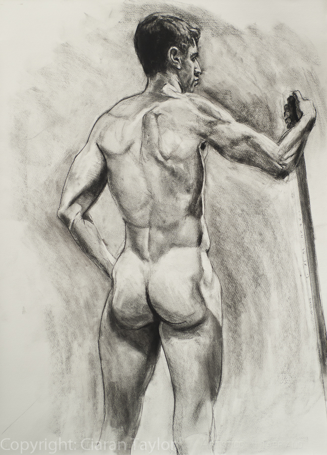 Life model Darren and the Pole, back view,                     nude, standing, by Ciaran Taylor, Irish artist. Charcoal